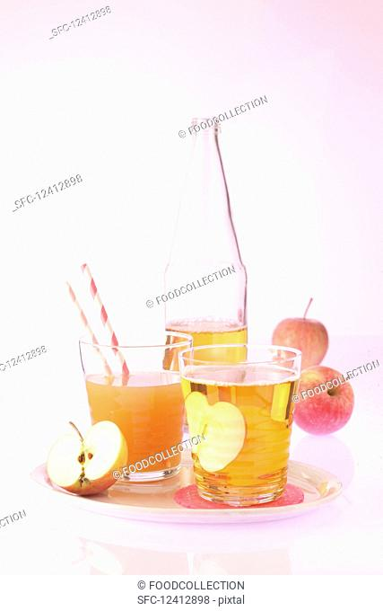 An arrangement of fruit juices (apple juice, and pear and orange juice)
