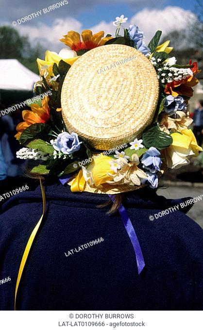 Huddersfield. Marsden. Clog morris dancer. Person wearing straw hat decorated with flowers. Traditional folk dancing