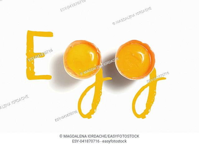 Word Egg Written With 2 Egg Yolks On White Table