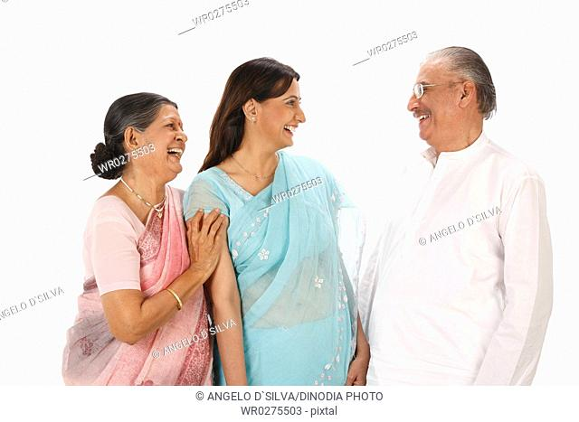 Young woman standing between old couple everyone laughing MR703P,703Q,703S