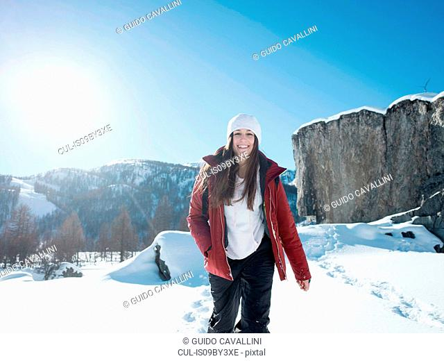 Young woman in knit hat in snow covered landscape, portrait, Alpe Ciamporino, Piemonte, Italy