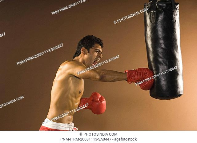Male boxer showing aggression during practice