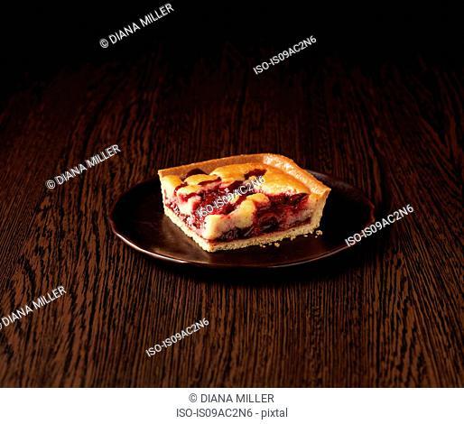 Slice of morello cherry frangipane tart