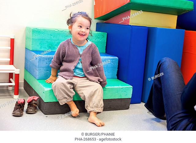 2 and a half year old girl with Down syndrome in psychomotricity session