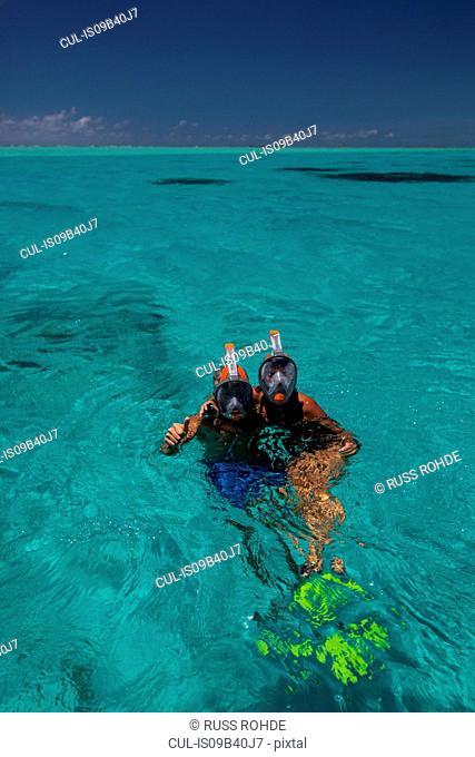 Portrait of mature couple in sea, wearing snorkel, Ile aux Cerfs, Mauritius