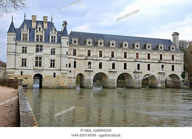 The west facade of the renaissance chateau de Chenonceau with its famous gallery crossing the river Cher, in France