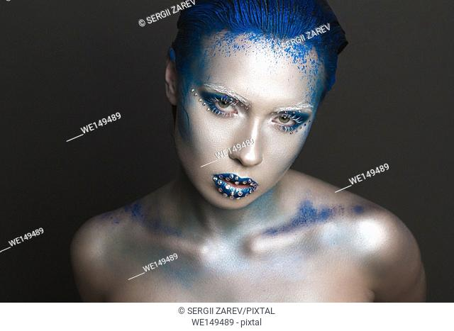 Cool Sexy Girl with Creative Festive Makeup. . . Art makeup with Blue Hair and Rhinestones on a Lips