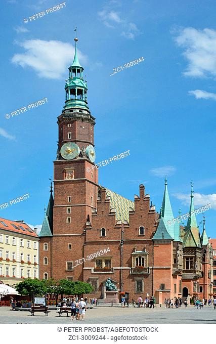 Town Hall on Market Square in the Old Town of Wroclaw with the Statue of the Polish poet, playwright and comedy writer Aleksander Fredro - Poland