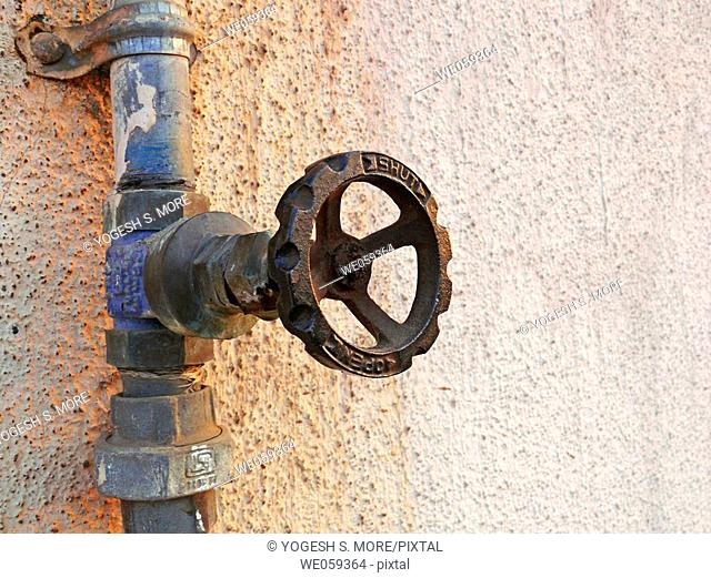 A revolving cock, tap of a water pipeline going to an overhead water storage on a building teracce. Vadgaon Budruk. Pune, Maharashtra, India