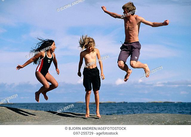 Three children jumping