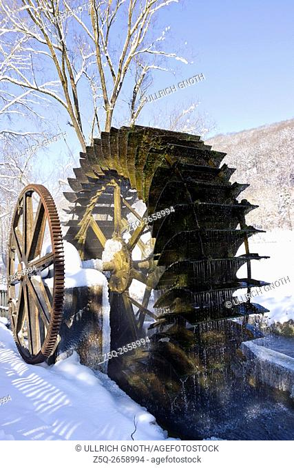 Old water wheel of an historic water mill in the Schmiechtal valley near Ulm, Germany