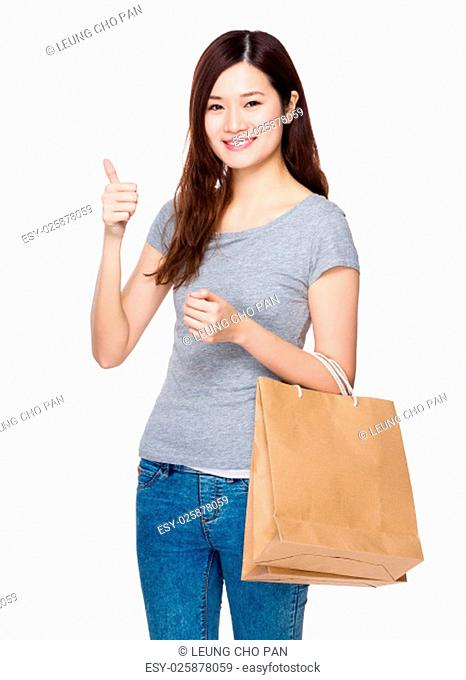 Asian young woman hold with shopping bag and thumb up