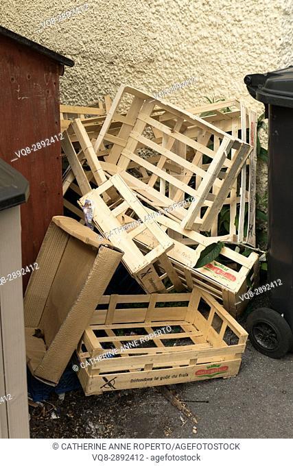 Pile of empty geometric wood and cardboard fruit trays near Coleridge's cottage, Nether Stowey, Somerset, UK