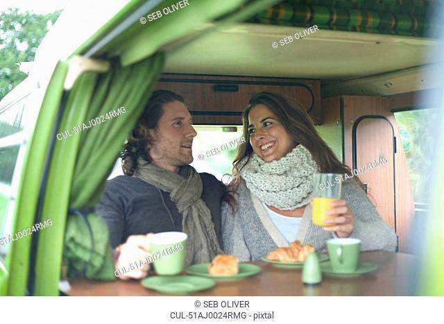 Couple eating breakfast in trailer
