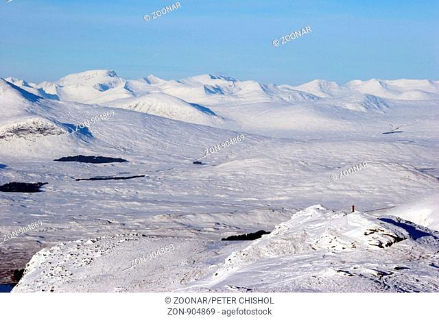 Hillwalker looking across the edge of Rannoch Moor to Ben Nevis,Aonach Mor and The Grey Corries