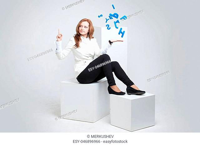 Young woman working with a set of letters, writing concept
