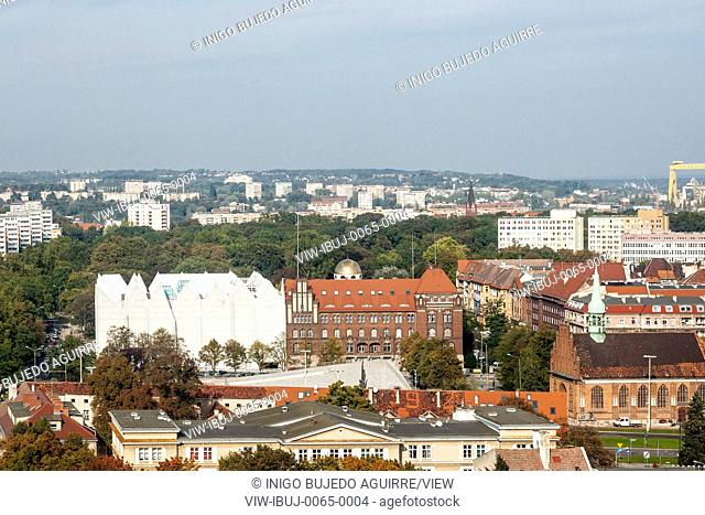 View from above towards concert hall and city. Szczecin Philharmonic Hall, Szczecin, Poland. Architect: Estudio Barozzi Veiga, 2014
