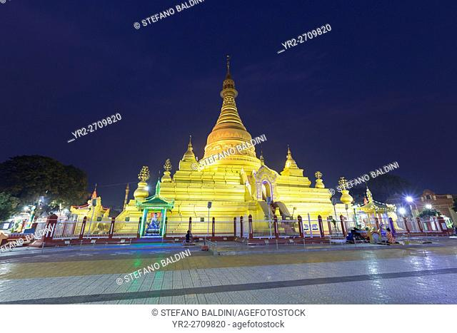 The beautifully proportioned stupa of the golden Eindawya Paya pagoda at night, Mandalay, Myanmar