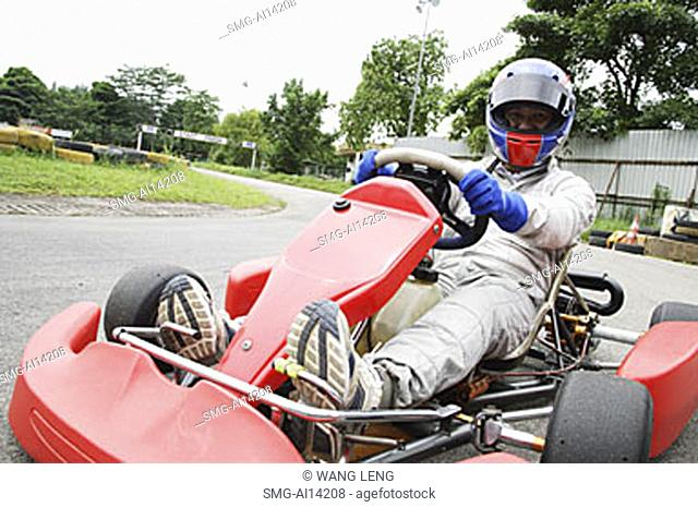 Young woman in go-cart, portrait