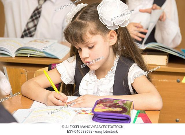 First-grader in class at school