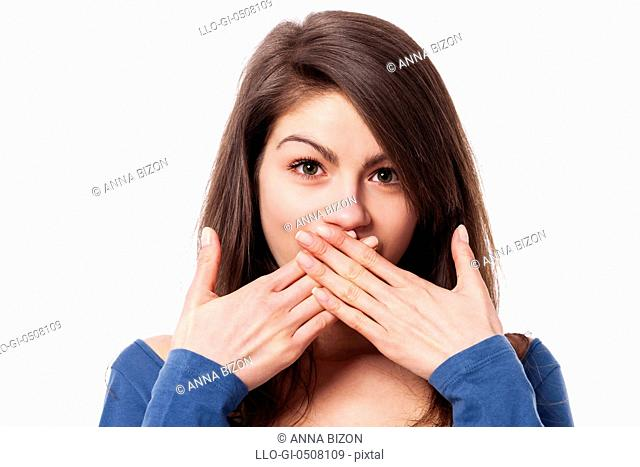 Beautiful young woman with hands covering mouth Debica, Poland
