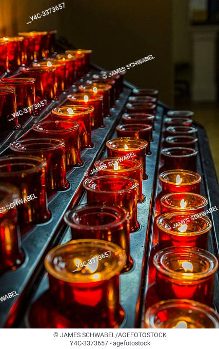 Votive candles or prayer candles in St Patricks Catholic Church in Newport in County Mayo Ireland