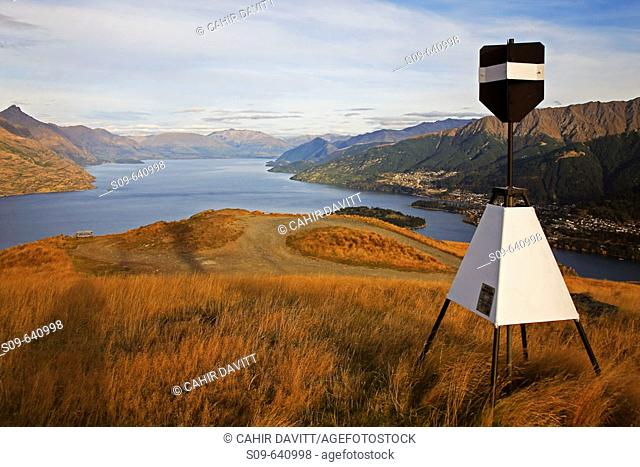Early morning view of Lake Wakatipu from Deerpark Heights with a trignometric survey marker in the foreground, Kelvin Peninsula, Queenstown, Otago & South land