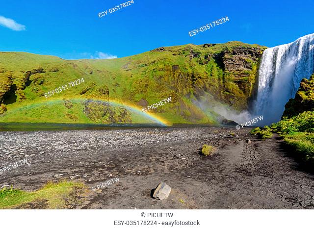 beautiful waterfall Skogafoss with rainbow, famous natural landmark in Iceland