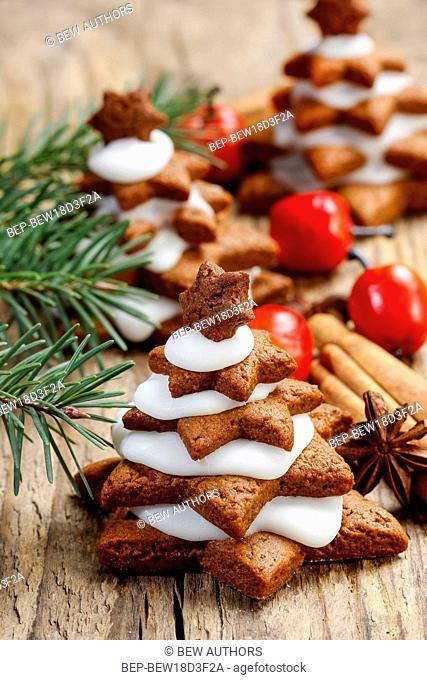 Gingerbread christmas tree on wooden table. Beautiful xmas setting