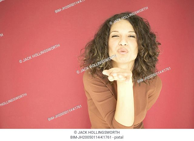 Young woman blowing a kiss