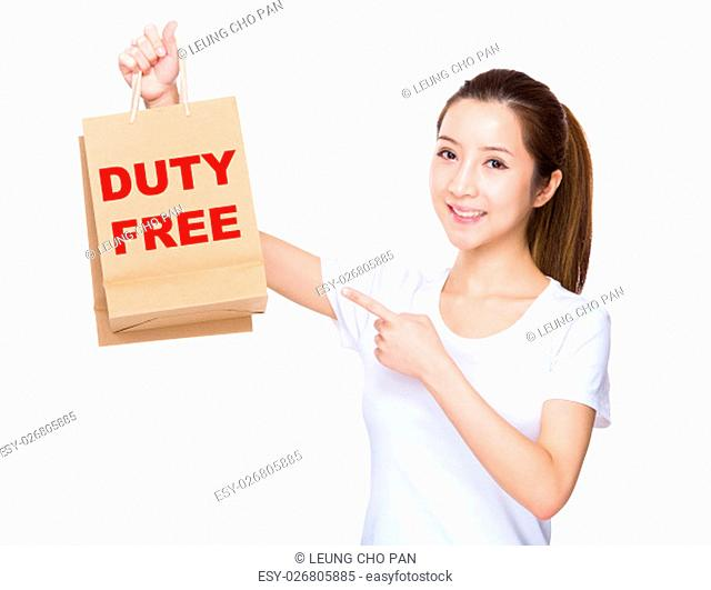 Woman finger point to shopping bag and showing phrase of duty free