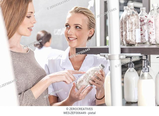 Client and shop assistant talking in wellness shop