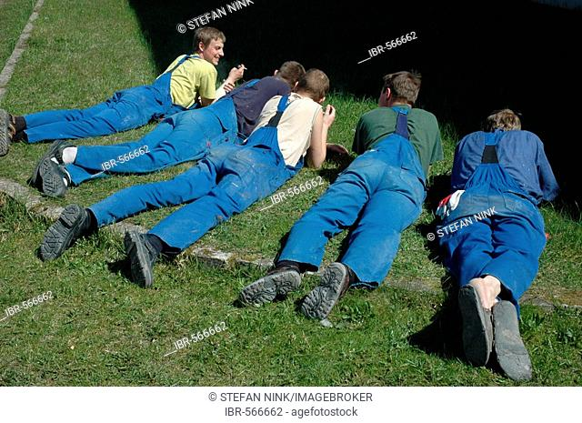 Lunch break, employees lying in th grass, Latvia