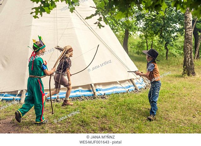 Germany, Saxony, Indians and cowboy party, Boys playing with bow and arrow