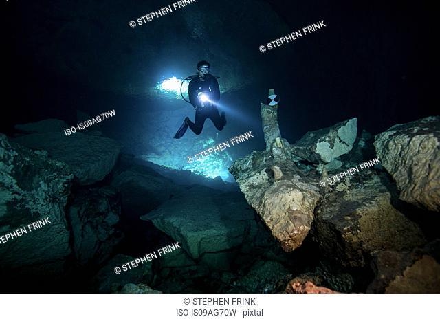 Scuba diver enters Ben's Cave