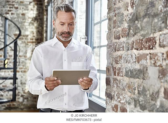 Businessman looking at tablet