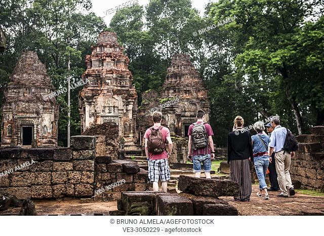 Tourists visiting Preah Ko temple in Angkor Complex (Siem Reap Province, Cambodia)