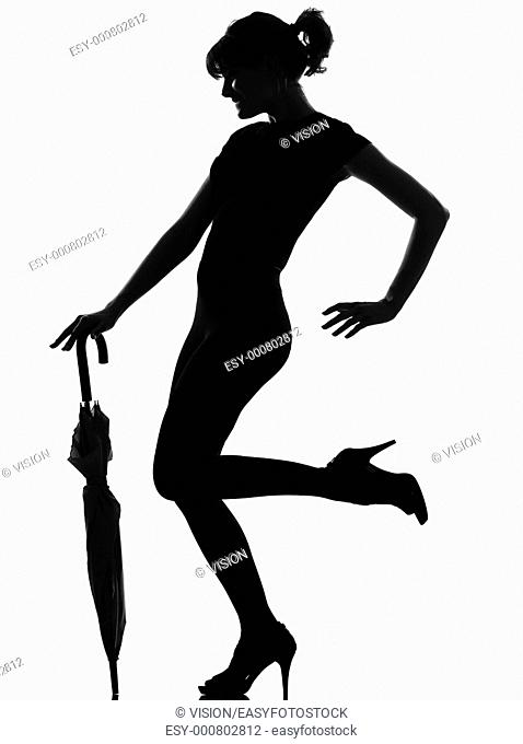 full length silhouette in shadow of a young woman with closed umbrella in studio on white background isolated