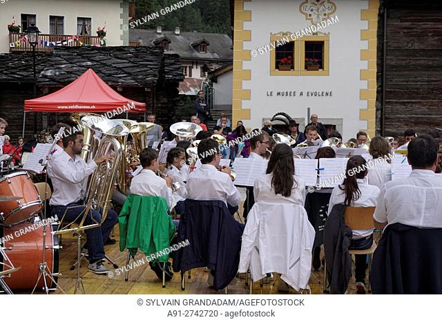 Switzerland, Valais, Val d'Herens, village of Evolene in summer during the august festival, the brass band from Les Hauderes (Guggen)