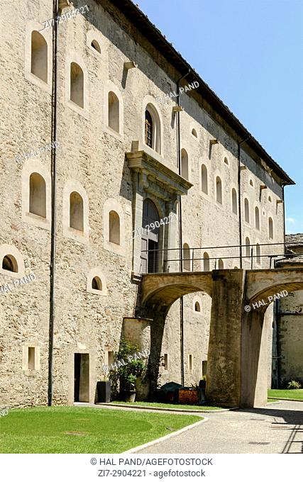 old mountain large fortification lower entrance bridge, shot on a bright summer day at Bard, Aosta valley, Italy