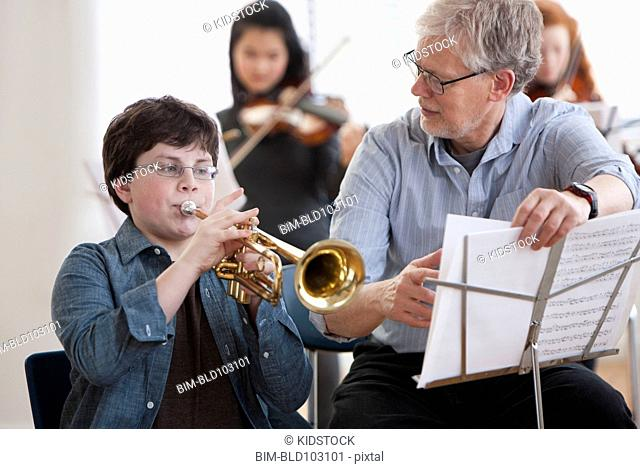 Student learning to play the trumpet