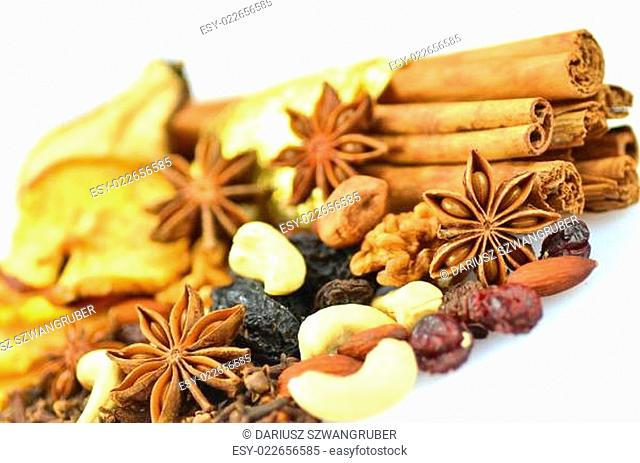 christmas spices, nuts and dried fruits isolated on white background