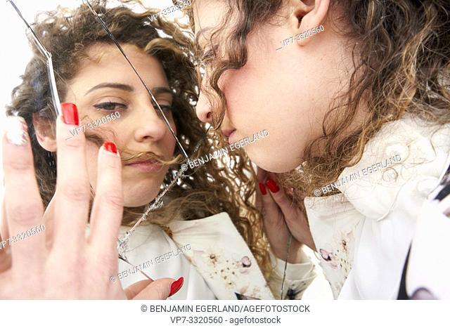 numb woman with broken mirror, in Paris, France