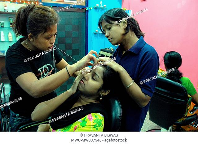 Plucking of eye brow at a beauty parlor in Kolkata September 17, 2005