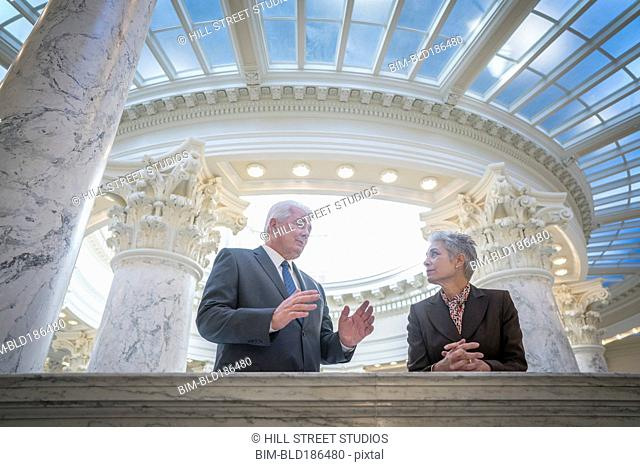 Caucasian senators talking in capitol