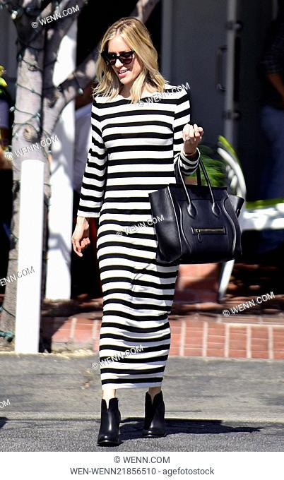 Kristin Cavallari looking stylish in a striped dress as she leaves the Fred Segal store Featuring: Kristin Cavallari Where: Los Angeles, California