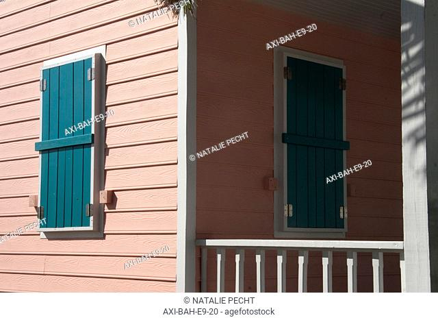 Pink clapboard house with green shutters. Abaco Islands, Elbow Cay, Hope Town, Bahamas