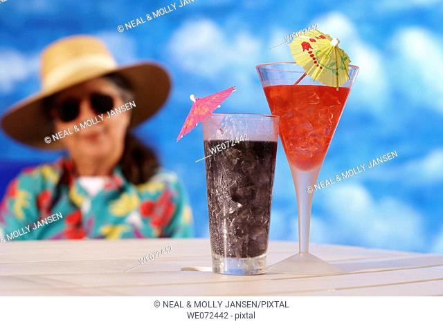 Woman Looking at Tropical Drinks