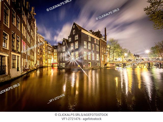 Amsterdam, houses reflecting on canal, Netherlands, Europe