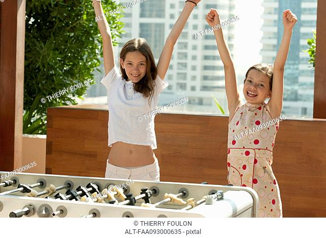 Girls winning at foosball